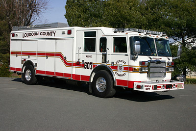 "Rescue 607 was established in November of 2010 with this 2007 Pierce Dash.  The Pierce was previously Rescue 603 in Middleburg, and came to Aldie when Middleburg discontinued heavy squad services.  With the delivery of the newer Pierce Rescue, this unit became R680, the county reserve.  Note the ladder storage on top of Rescue 607.  Photographing apparatus at Fire Station 7 can be ""tight"".  As with earlier photographs of Aldie apparatus, the crew took Rescue 607 to the Aldie Elementary school for some more room to move around for photographs."