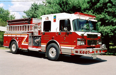"The officer side of Tanker 607, or ""K607"" as designated on the front bumper.  Tanker 607 was taken to the Aldie Elementary School for photographs."