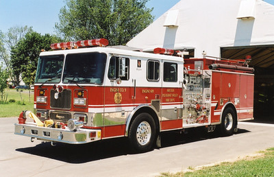 "Although assigned to Station 9 in Arcola, this 1999 Seagrave spent a good portion of its career as the first engine for South Riding Station 19.  The Seagrave is equipped with a 1500/750.    The Seagrave was photographed in front of ""The Big Top"", which was the original and temporary Station 19 in South Riding.  ""The Big Top"" is now used at the Training Center to house training apparatus."