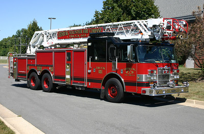 In 2013, Leesburg Truck 601 had some revisions made.  The wheel covers were removed and the wheels painted red.  A black stripe was painted on the outer section of each wheel and the wheel nuts were painted black with the tips red.  A Roto-Ray warning light had also been added.  Truck 601 is a 2012 Pierce Dash 105' aerial that was purchased in 2011 from Brindlee Mountain, a used fire apparatus dealer.  The Pierce originally served Ormond Beach, Florida, and prior to that, was a Pierce demonstrator.