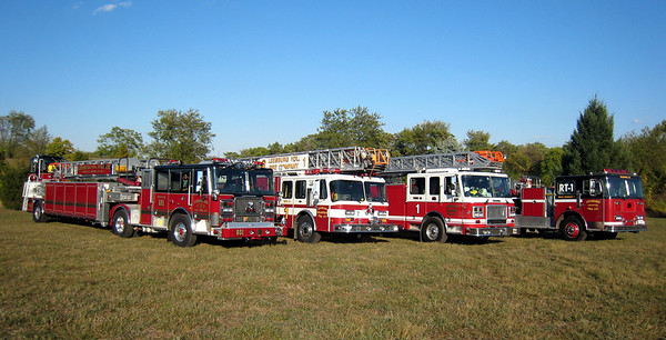 A rare opportunity in Leesburg - the opportunity to photograph four ladder trucks in Leesburg at one time.  The 2007 Seagrave tiller (on the left) had just been delivered and was still being prepared for service.  Next to the Seagrave tiller is the 1992 Emergency One Hurricane 110' which was having some mechanical issues.  A 2004 Seagrave loaner, marked up for Leesburg, is next followed by the 1988 Seagrave 100' tiller (far right) training aerial which was purchased for training in preparation of the arrival of the 2007 Seagrave tiller.  Room to get these ladder trucks together was accomplished at Ida Lee Park in Leesburg.