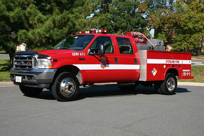 "SERV 611 is Sterling's multi-purpose truck.  In addition to providing ""SERV"" duties, it has been equipped with a brush skid package to help fight outside and smaller fires.  The 2002 Ford F450 with a Knapheide body originally entered service as SERV 18 in Cascades.  When the department purchased a newer 2005 Ford F550/Knapheide, this Ford was re-assigned to Station 11 as SERV 611.  In 2008, a brush skid package was purchased from Vigilant Brush Equipment in New York and SERV 611 is equipped with a 400 gpm pump, carries 250 gallons of water, and 10 gallons of foam.  This truck eluded me for quite some time before I was finally able to photograph it in October of 2011 near Fire Station 11."