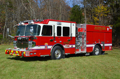 Engine 611 as photographed in October of 2014 just prior to being delivered to Sterling Fire.  It is a 2014 Spartan Gladiator/Smeal equipped with a 1500/750/20 and assigned Smeal s.o. number 4299.  Sterling ordered two identical engines for Engine 611 and Engine 624.