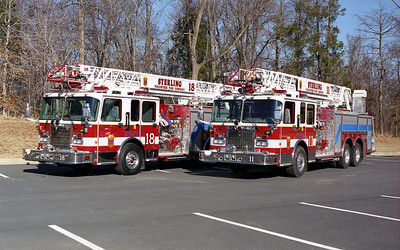 Sterling Fire took delivery of identical Spartan Gladiator/Smeal 75' rearmount quints in 2000.  They are equipped with 1500 gallon per minute pumps and 500 gallon water tanks.  Quint 11 remains on the Sterling apparatus roster.  Quint 18 was sold in 2007 to the Carter VFD in Dale, Indiana where the Quint is the first due ladder truck at Holiday World in Santa Claus, Indiana.  This group photograph was taken just after Sterling received the new quints and preparing them for service at Station's 11 and 18.