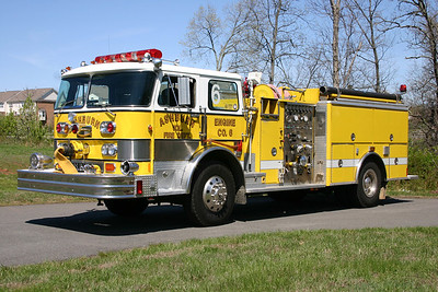 Ashburn's first custom fire truck was this 1980 Hahn  1000/500.  In 1993, a new Hahn body was obtained from the Hahn company just prior to Hahn closing.  LSI of Purcellville did the rehab work.  LSI mounted the body, added a front intake, and upgraded the warning lights.  The Hahn is still owned today by Ashburn and is used as a ceremonial truck, parades, etc.  This photograph was taken at an Ashburn baseball park near Fire Station 23, where the Hahn was often kept.