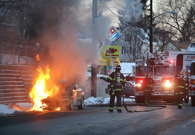 Lowell firefighter put out car fire on Bridge Street