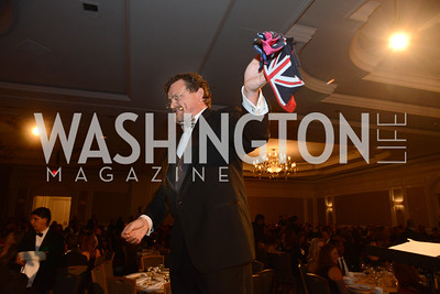Auctioneer, Patrick O'Neill auctions off some pairs of socks of British Ambassador, Sir Peter Westmacott. MS Ambassadors Ball, September 10, 2014, Photo by Neshan H. Naltchayan