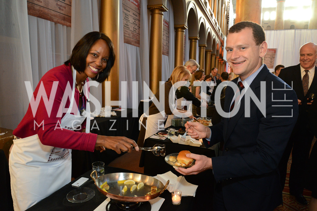 Maya Cummings serves her classic Maryland Crab Cakes to Serge Eygenson.     March of Dimes Gourmet Gala, National Building Museum. May 7, 2014 Photo by Neshan H. Naltchayan