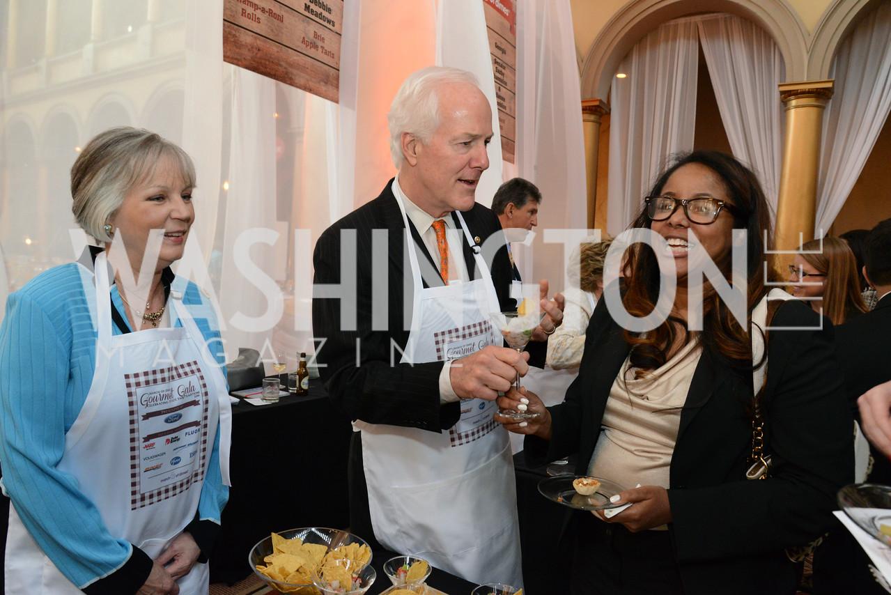 Sandy Cornyn, Senator John Cornyn (R-TX) serve Sandra Lee.                March of Dimes Gourmet Gala, National Building Museum. May 7, 2014 Photo by Neshan H. Naltchayan