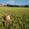 A Kid in a Farm Field