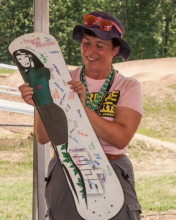 Denise receiving gift of Mountainboard from Team.