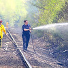 Ashburnham fire Lt. Bob Plant and Ashburnham Firefighter Michele Boirier help fight a brush fire that broke out near the train tracks off of Murray Road in Ashburnham on Tuesday afternoon. SENTINEL & ENTERPRISE/JOHN LOVE