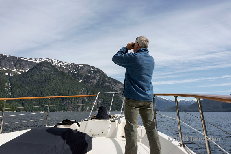 Scanning the high cliffs for mountain goats, Mussel Inlet, mid-coast British Columbia