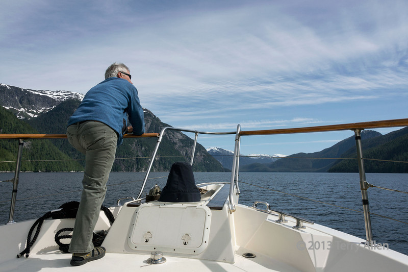 """A beautiful morning in the Great Bear Rainforest<br /> <br /> Boater enjoying the scenery, Mussel Inlet, mid-coast British Columbia.  This area is part of the Fiordland Conservancy, a large marine park that includes one of the finest examples of glacially gouged fiords on the British Columbia coast, where sheer granite cliffs rise more than 1000 metres out of the sea.  Other shots of the cliffs and waterfalls of this beautiful area can be seen here: <a href=""""http://goo.gl/cvCAkd"""">http://goo.gl/cvCAkd</a><br /> <br /> 9/10/13  <a href=""""http://www.allenfotowild.com"""">http://www.allenfotowild.com</a>"""