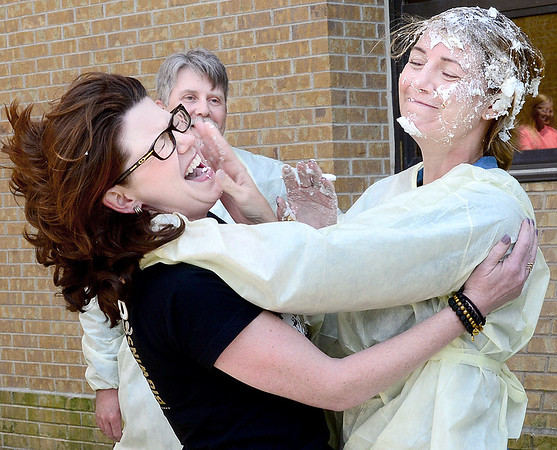 Kevin Harvison   Staff photo<br /> Lori Few gets a taste of her own medicine after she put a pie in the face of McAlester Regional Hospital employee Rachel Fields during a pie in the face fundraiser through the McAlester Regional Hospital Foundation Friday. A $1 vote for who would take a pie to the face raised about $2,500.