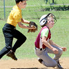 Staff photo by Kevin Harvison |<br /> Left, Henryetta Roughneck player attempts to tag McAlester Boys Club baserunner, Spencer Stinchcomb, during Sertoma Championship Series 10U baseball action Sunday in McAlester.