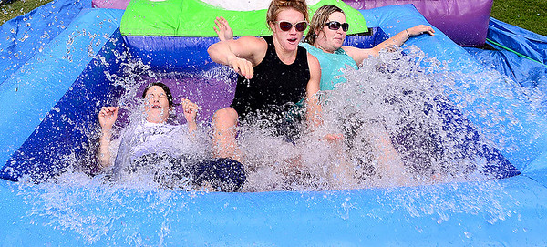 "Staff photo by Kevin Harvison |<br /> Some Washington Early Childhood Center staff volunteered to go down the inflatable waterslide during the schools ""fun day."" Pictured from left are Barbee Hendrix, Holly Ledford and Tiffany Villa."