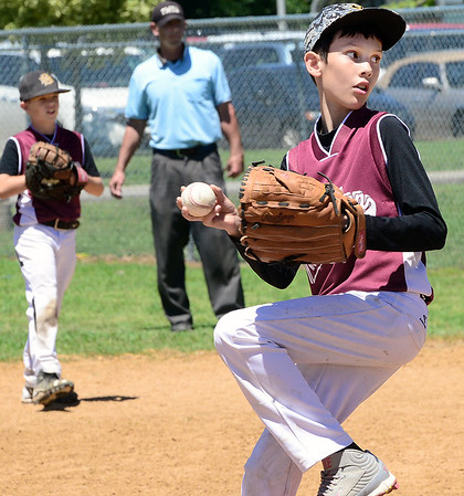 Staff photo by Kevin Harvison |<br /> Evan Lake, right, delivers a pitch for the 10U Boys Club team Saturday at the Sertoma Championship Series Tournament.