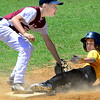 Staff photo by Kevin Harvison |<br /> McAlester Boys Club third baseman, Tristen Jewell, left, tags out a Heneryetta Roughneck base runner during pool play action of the Sertoma Championship Tournament Series Sunday.