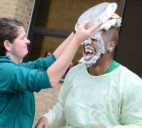 Kevin Harvison   Staff photo <br /> Michelle Chancellor, left gives Johnny Cullin III a second helping during a pie in the face fundraiser Friday.