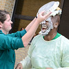 Kevin Harvison | Staff photo <br /> Michelle Chancellor, left gives Johnny Cullin III a second helping during a pie in the face fundraiser Friday.
