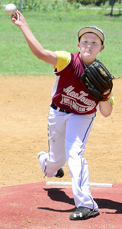 Staff photo by Kevin Harvison |<br /> Jack Morgan delivers a pitch for the McAlester 10U Boys Cub baseball team during Sunday action from the Sertoma Championship Series Tournament.