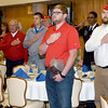 Submitted photo by U.S. Army photo by KEVIN JACKSON | Attendees salute the flag during the playing of the National Athem.