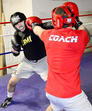 Kevin Harvison | Staff photo<br /> Brandon Clement, left, fighting out of Thunder Foot Bailey's gym in Krebs, does some sparring with Yon Harvison, of Hitman Academy in Hugo, as Clement prepares for a May 6 fight for state middle weight title at the BOK Center in Tulsa.