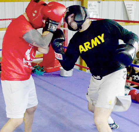 Kevin Harvison | Staff photo<br /> Brandon Clement, right, fighting out of Thunder Foot Bailey's gym in Krebs, does some sparring with Yon Harvison, left, of Hitman Academy in Hugo, as Clement prepares for a May 6 fight for state middle weight title at the BOK Center in Tulsa.