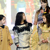 Kevin Harvison | Staff photo<br /> Pictured from left Emerson Elementary students, Cambriah Eubanks, Ayla Watson, Kajua Walter listen to Jackie Washington as she gives a cultural presentation.