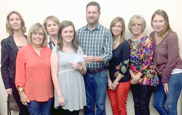 Lacey Sudderth | Staff photo <br /> Beta Iota donated funds to Shared Blessings, Pictured from left to right is Rachel Fields, June Miller, Cindy Pingleton, BETA IOTA President Megan Higgins, Shared Blessings Development Director Joey Clark, Jennifer Stewart, Alice Riback and Tarra Singleton.