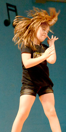 Staff photo by Kevin Harvison  <br /> Emerson Elentary student Maylynn Henry performs a dance routine during the school's talent show.