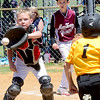 Staff photo by Kevin Harvison |<br /> McAlester Boys Club catcherTreton Salyer, left, eyes the runner during a play at the plate Sunday during the Sertoma Championship Series Baseball Tournament at the Bud Hale Complex.