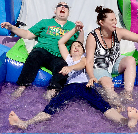 Staff photo by Kevin Harvison |<br /> Washington Early Childhood Center Staff members react to stopping just short of the water while trying out the inflatable water slide during the schools fun day. Pictured from left are LeeAnna Sturgeion, Barbee Hendrix and Nikki Walling.