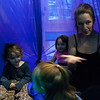 """Kayla Rice/Reformer<br /> Director of Youth Programming Erin Lovett-Sherman plays in the aerial fabrics with children ages 1.5-4 during the New England Center for Circus Arts' """"Tots"""" class at Cotton Mill Hill on January 20th."""