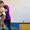 """Kayla Rice/Reformer<br /> Director of Youth Programming Erin Lovett-Sherman helps Lillian Newton, 2 1/2, walk across the tightwire during the New England Center for Circus Arts' """"Tots"""" class at Cotton Mill Hill on January 20th."""