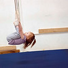 """Kayla Rice/Reformer<br /> Lightning Knudson, 2 1/2, swings on a trapeze bar during the New England Center for Circus Arts' """"Tots"""" class at Cotton Mill Hill in Brattleboro on January 20th."""