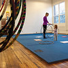 """Kayla Rice/Reformer<br /> Director of Youth Programming Erin Lovett-Sherman hula hoops with Lightning Knudson, 2 1/2, during the New England Center for Circus Arts' """"Tots"""" class at Cotton Mill Hill on January 20th."""