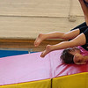 """Kayla Rice/Reformer<br /> Director of Youth Programming Erin Lovett-Sherman helps Maizy Shooer-Sampson, 4, with a backwards somersault during the New England Center for Circus Arts' """"Tots"""" class for ages 1.5-4 years at Cotton Mill Hill in Brattleboro on January 20th."""