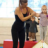 """Kayla Rice/Reformer<br /> Director of Youth Programming Erin Lovett-Sherman helps Lightning Knudson, 2 1/2, walk across the tightwire during the New England Center for Circus Arts' """"Tots"""" class at Cotton Mill Hill on January 20th."""