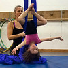 """Kayla Rice/Reformer<br /> Director of Youth Programming Erin Lovett-Sherman helps Maizy Shooer-Sampson, 4, use fabrics during the New England Center for Circus Arts' """"Tots"""" class at Cotton Mill Hill on January 20th."""