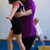 """Kayla Rice/Reformer<br /> Director of Youth Programming Erin Lovett-Sherman helps Maizy Shooer-Sampson, 4, walk across the tightwire during the New England Center for Circus Arts' """"Tots"""" class at Cotton Mill Hill on January 20th."""