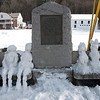 Kayla Rice/Reformer<br /> Snow people and animals sit on a bench on the common in Newfane.