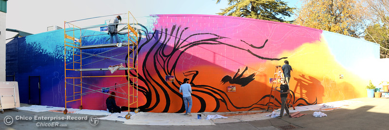 Panorama of Fifth Sun artists work Friday, Dec. 4, 2015, on a mural at the Boys and Girls Club in Chico, California. (Dan Reidel -- Enterprise-Record)