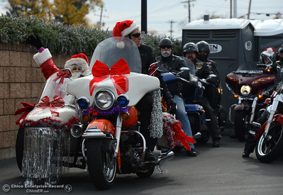 Santa Claus rides with Ron Hall as riders take toys by motorcycle from the Silver Dollar Fairgrounds to Calvary Chapel of Paradise on Saturday, Dec. 5, 2015, during the Butte County Motorcycle Toy Run in Chico, California. (Dan Reidel -- Enterprise-Record)