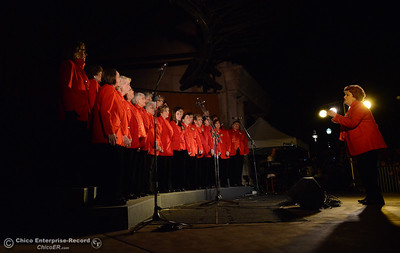 Lu Fox, right, leads the Sounds of the Valley Chorus in Christmas carols before the 62-foot tall Blue Aspen is lit with 8,000 electric lights Friday, Dec. 4, 2015, at the annual Christmas Tree Lighting in Chico, California. (Dan Reidel -- Enterprise-Record)