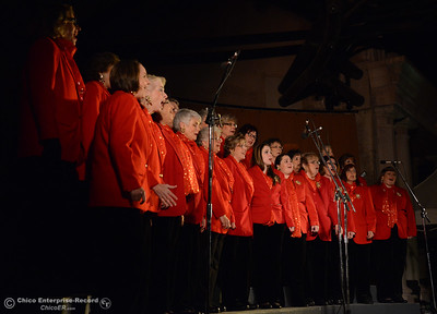 The Sounds of the Valley Chorus sings carols before the 62-foot tall Blue Aspen is lit with 8,000 electric lights Friday, Dec. 4, 2015, at the annual Christmas Tree Lighting in Chico, California. (Dan Reidel -- Enterprise-Record)