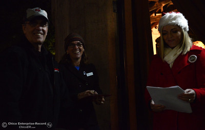 Left to right, Mike Wessels, Steph Yunker and Megan McMann backstage before the 62-foot tall Blue Aspen is lit with 8,000 electric lights Friday, Dec. 4, 2015, at the annual Christmas Tree Lighting in Chico, California. (Dan Reidel -- Enterprise-Record)
