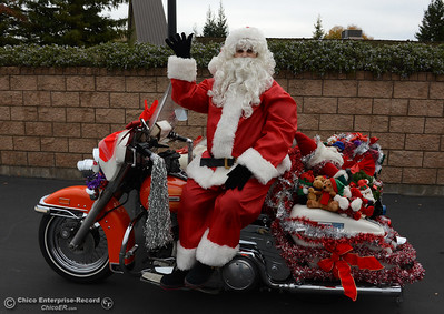 Santa Claus is ready to go as riders take toys by motorcycle from the Silver Dollar Fairgrounds to Calvary Chapel of Paradise on Saturday, Dec. 5, 2015, during the Butte County Motorcycle Toy Run in Chico, California. (Dan Reidel -- Enterprise-Record)
