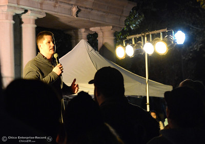 Chico Vice-Mayor Sean Morgan talks to the crowd before the 62-foot tall Blue Aspen is lit with 8,000 electric lights Friday, Dec. 4, 2015, at the annual Christmas Tree Lighting in Chico, California. (Dan Reidel -- Enterprise-Record)